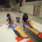 Nancy Deleary and Danielle Burch put final touches on the Tecumseh Barn Quilt, one of 31 Barn Quilt in and around COTTFN
